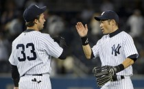 Nick Swisher and right fielder Ichiro Suzuki