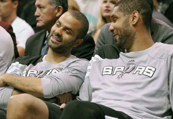 San Antonio Spurs point guard Tony Parker and center Tim Duncan talk on the bench during the second half of their NBA basketball game against the Utah Jazz in Salt Lake City, Utah